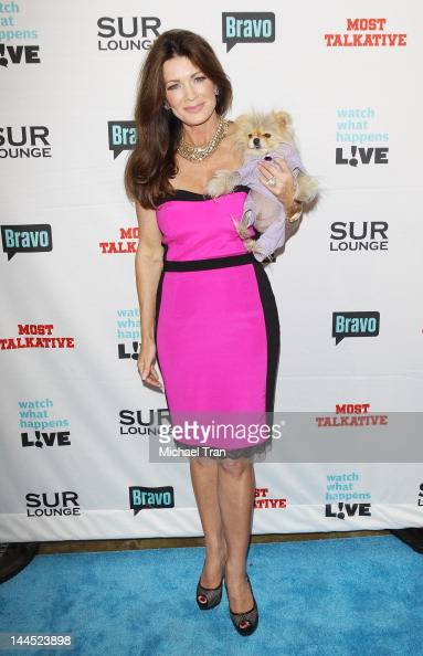 Lisa Vanderpump and her dog Giggy arrive at Bravo's Andy Cohen's book release party for 'Most Talkative Stories From The Front Lines Of Pop Culture'...