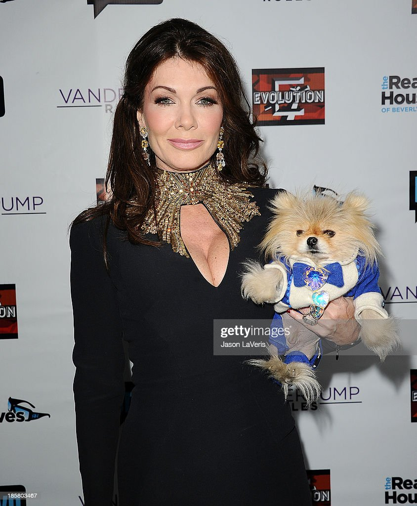 Lisa Vanderpump and her dog Giggy The Pom attend the 'The Real Housewives of Beverly Hills' and 'Vanderpump Rules' premiere party at Boulevard3 on October 23, 2013 in Hollywood, California.