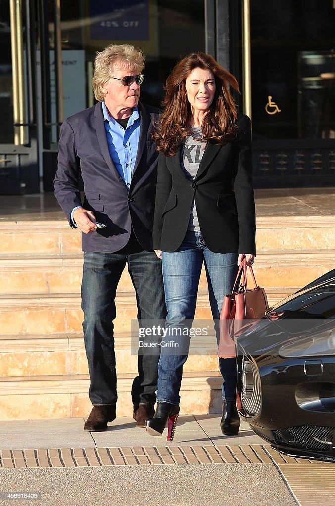 Lisa Vanderpump and her husband, Ken Todd, are seen shopping at Barneys New York on December 22, 2013 in Los Angeles, California.