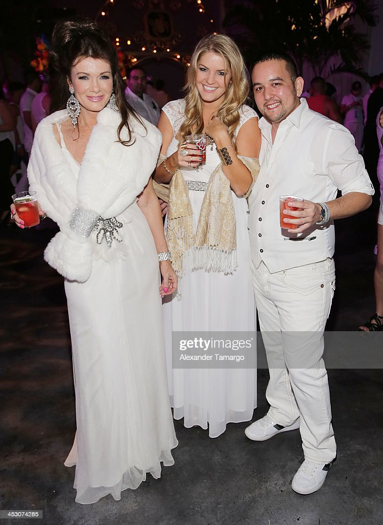 Lisa Vanderpump and Pandora Vanderpump-Sabo pose with a guest during the debut of LVP sangria at The White Party in Miami and help raise awareness for HIV/AIDS at Soho Studios on November 30, 2013 in Miami, Florida.