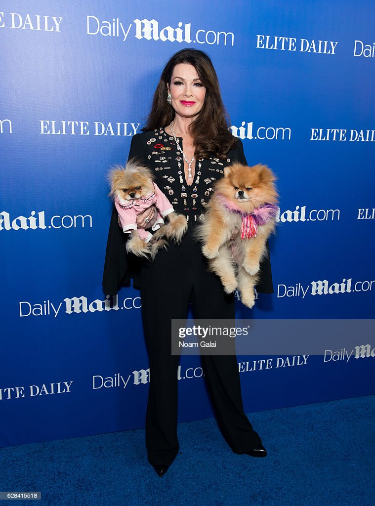 Lisa Vanderpump poses with her dogs Giggy and Puffy at the DailyMail.com and Elite Daily holiday party at Vandal on December 7, 2016 in New York City.