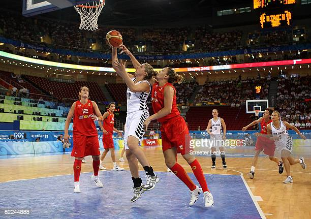 Lisa Wallbutton of New Zealand drives for a shot attempt against Maria Lucila Pascua of Spain during their women's basketball game on Day 3 of the...