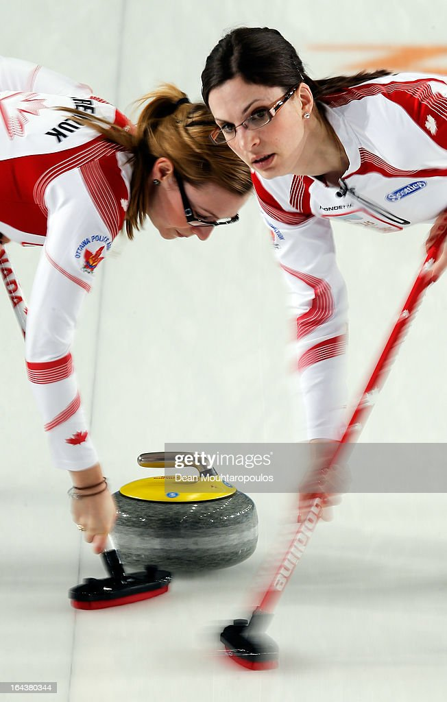 Lisa Weagle (R) and Alison Kreviazuk (L) of Canada sweep during the Semi Final match between Scotland and Canada on Day 8 of the Titlis Glacier Mountain World Women's Curling Championship at the Volvo Sports Centre on March 23, 2013 in Riga, Latvia.