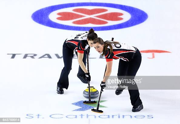 Lisa Weagle and Emma Miskew of Ontario sweep in a draw eleven match against Newfoundland Labrador during the 2017 Scotties Tournament of Hearts at...
