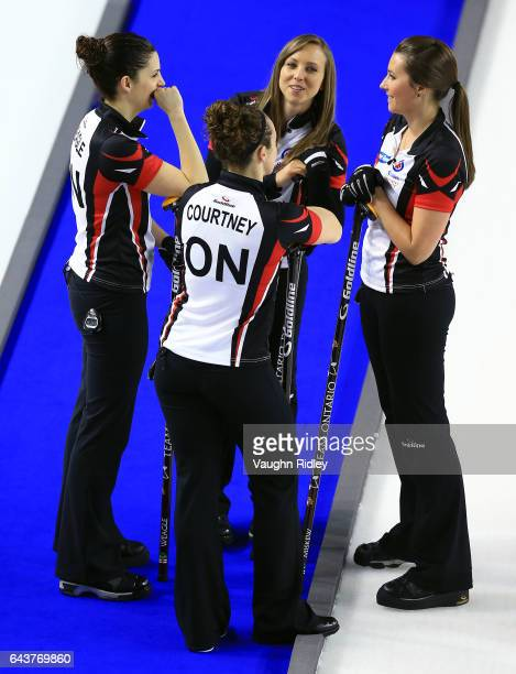 Lisa Weagle Joanne Courtney Rachel Homan and Emma Miskew of Ontario talk between ends in a draw eleven match against Newfoundland Labrador during the...