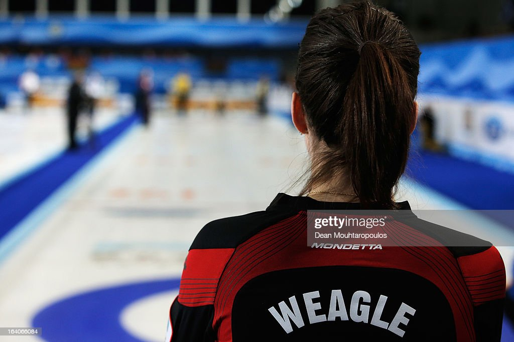 Lisa Weagle of Canada waits for Sweden to throw their stone in the match between Canada and Sweden on Day 4 of the Titlis Glacier Mountain World Women's Curling Championship at the Volvo Sports Centre on March 19, 2013 in Riga, Latvia.
