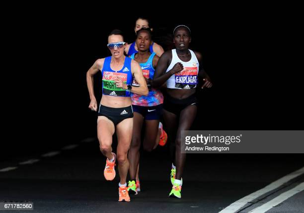 Lisa Weightman of Australia and Florence Kiplagat of Kenya compete during the Virgin Money London Marathon on April 23 2017 in London England