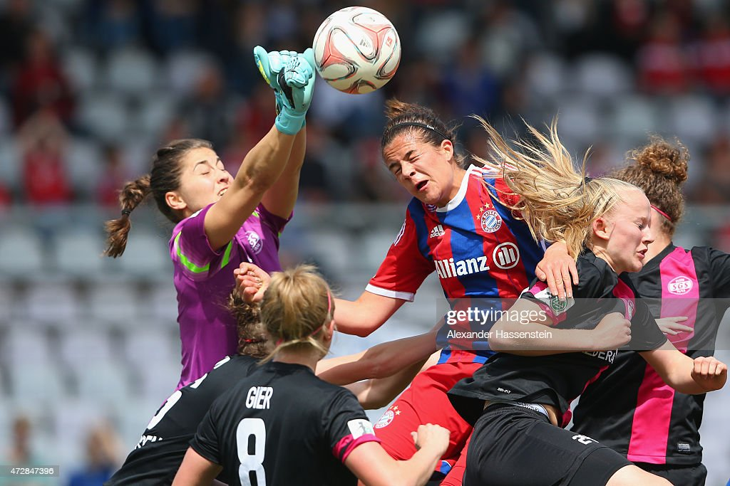 Lisa Weiss, keeper of Essen saves the ball against Lena Lotzen of Muenchen during the Allianz Frauen-Bundesliga match between FC Bayern Muenchen and SGS Essen at Stadion an der Gruenwalder Strafle on May 10, 2015 in Munich, Germany.