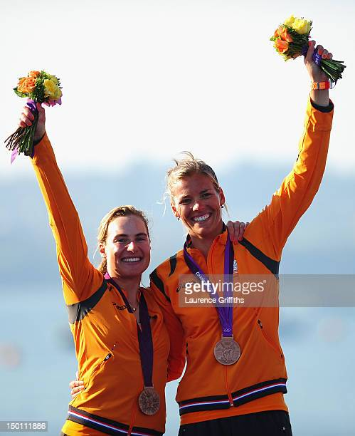 Lisa Westerhof and Lobke Berkhout of Netherlands celebrate finishing third and winning the bronze medal in the 470 Women's Class Sailing on Day 14 of...