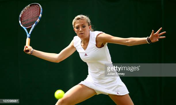 Lisa Whybourn of Great Britain plays a forehand in her match against Sally Peers of Australia during qualifying for Wimbledon 2010 Tennis at...