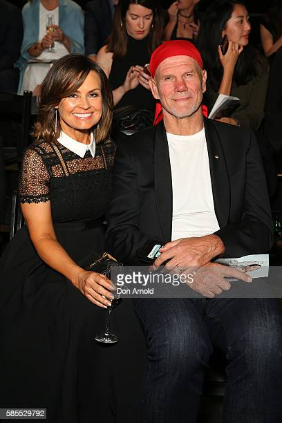 Lisa Wilkinson and Peter Fitzsimmons sit front row ahead of the runway at the David Jones Spring/Summer 2016 Fashion Launch at Fox Studios on August...