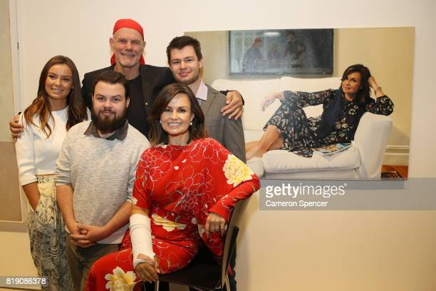 Lisa Wilkinson poses with her husband Peter FitzSimons and family in front of a portrait of her by artist Peter Smeeth after it was awarded the 2017...