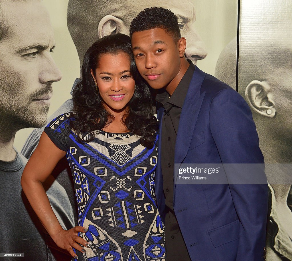 Lisa Wu and guest attend Furious 7 advance screening at Regal Atlantic Station on April 1 2015 in Atlanta Georgia