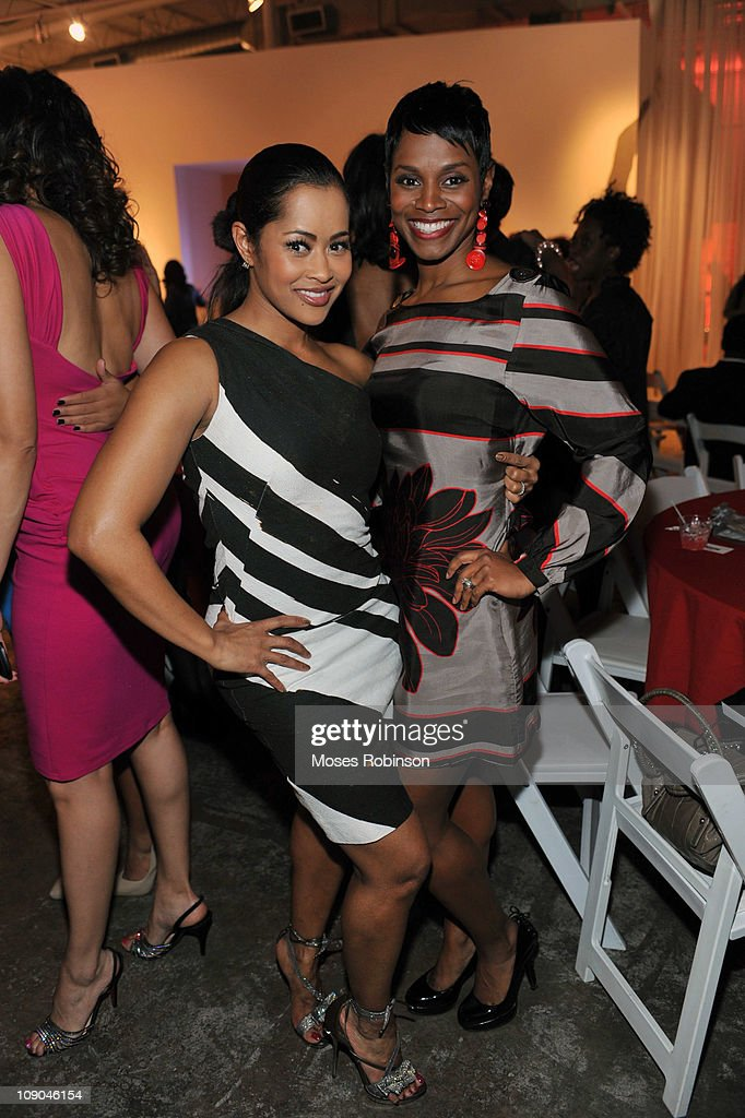 Lisa Wu Hartwell and Rashan Ali attend the Women On The Move Honoree Celebration at the Mason Murer Fine Art Museum on February 12 2011 in Atlanta...