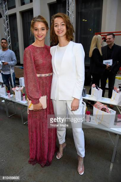LisaMarie Koroll and her sister LaraSofie Koroll attend the Marina Hoermanseder show during the Berliner Mode Salon Spring/Summer 2018 at...