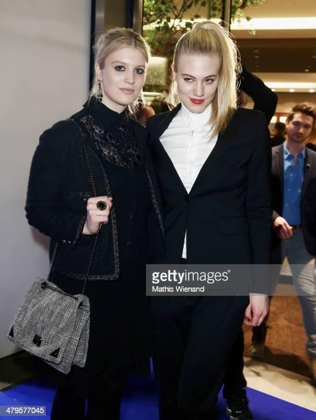 LisaMarie Marolt and Larissa Marolt attend the Joop Store Opening at Koe Bogen Dusseldorf on March 19 2014 in Dusseldorf Germany