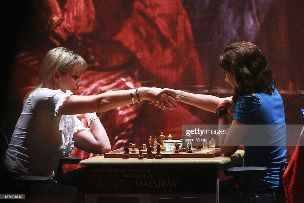 Lisandra Ordaz from Cuba and Olga Aleksandrova from Spain play the final chess game Foursquare Blindfold and Rapid Tournament, as part of the Second Great International Chess Festival UNAM 2012 at the Sala Nezahualcoyotl on November 25, 2012, in Mexico City, Mexico.