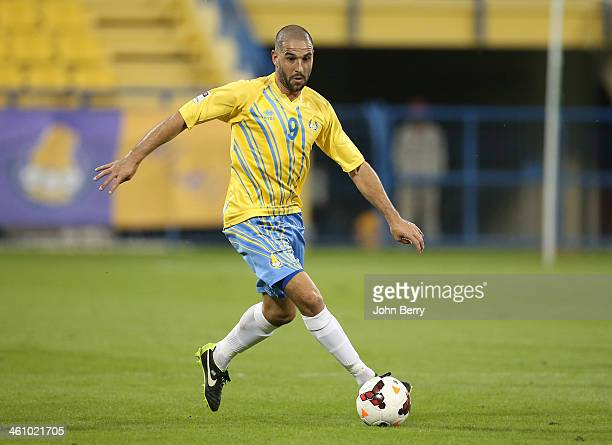 Lisandro Lopez of Al Gharafa in action during the friendly match between Al Gharafa SC and Schalke 04 at the Al Gharafa Stadium on January 6 2014 in...