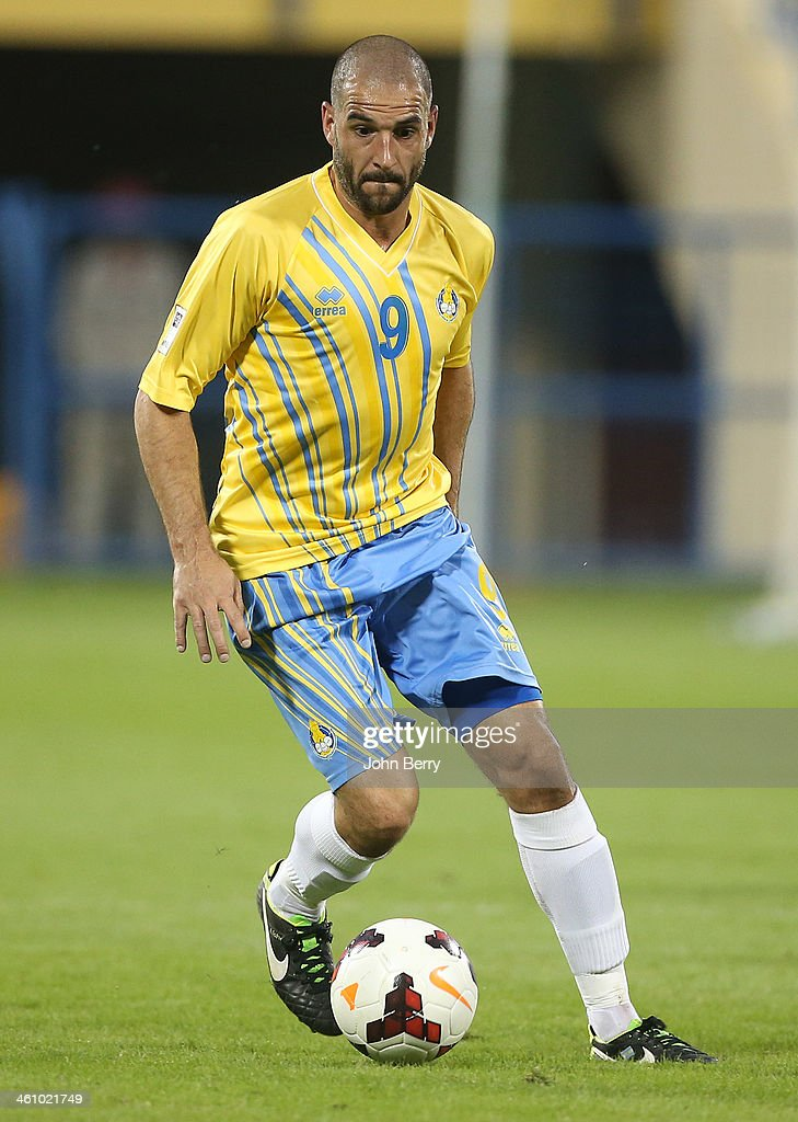 <a gi-track='captionPersonalityLinkClicked' href=/galleries/search?phrase=Lisandro+Lopez&family=editorial&specificpeople=801562 ng-click='$event.stopPropagation()'>Lisandro Lopez</a> of Al Gharafa in action during the friendly match between Al Gharafa SC and Schalke 04 at the Al Gharafa Stadium on January 6, 2014 in Doha, Qatar.