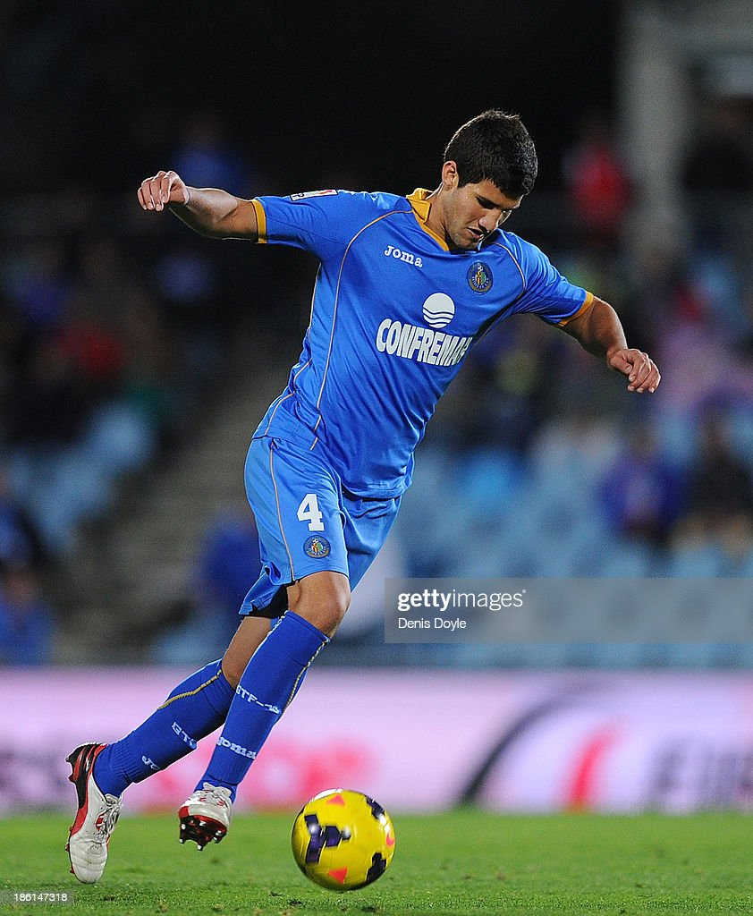 <a gi-track='captionPersonalityLinkClicked' href=/galleries/search?phrase=Lisandro+Lopez&family=editorial&specificpeople=801562 ng-click='$event.stopPropagation()'>Lisandro Lopez</a> of Getafe CF in action during the La Liga match between Getafe CF and Athletic Club at Coliseum Alfonso Perez stadium on October 28, 2013 in Getafe, Spain.
