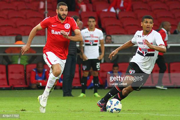 Lisandro Lopez of Internacional battles for the ball against Denilson of Sao Paulo during match between Internacional and Sao Paulo as part of...