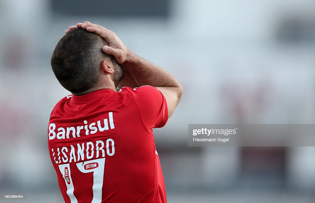 <a gi-track='captionPersonalityLinkClicked' href=/galleries/search?phrase=Lisandro+Lopez&family=editorial&specificpeople=801562 ng-click='$event.stopPropagation()'>Lisandro Lopez</a> of Internacional reacts during the match between Ponte Preta and Internacional for the Brazilian Series A 2015 at Moises Lucarelli Stadium on July 26, 2015 in Campinas, Brazil.
