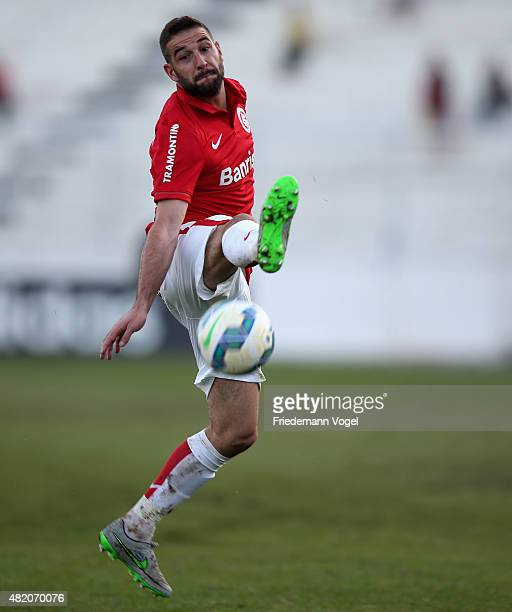 Lisandro Lopez of Internacional runs with the ball during the match between Ponte Preta and Internacional for the Brazilian Series A 2015 at Moises...
