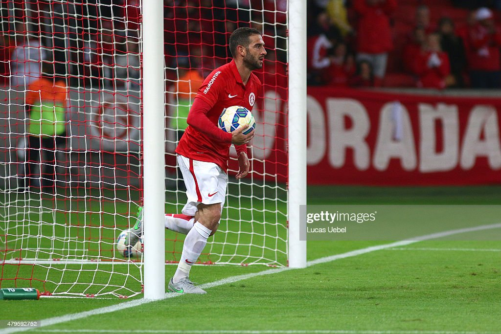 <a gi-track='captionPersonalityLinkClicked' href=/galleries/search?phrase=Lisandro+Lopez&family=editorial&specificpeople=801562 ng-click='$event.stopPropagation()'>Lisandro Lopez</a> of Internacional scores their first goal during the match between Internacional and Atletico-MG as part of Brasileirao Series A 2015, at Estadio Beira-Rio on July 05, 2015, in Porto Alegre, Brazil.