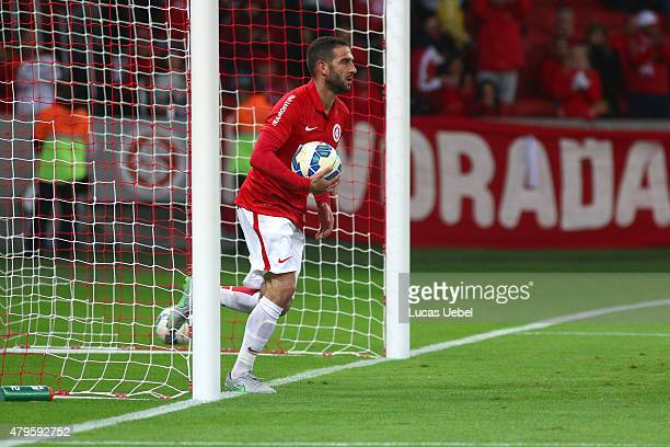 Lisandro Lopez of Internacional scores their first goal during the match between Internacional and AtleticoMG as part of Brasileirao Series A 2015 at...