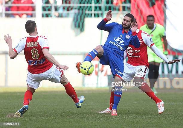 Lisandro Lopez of Lyon and Johan Ramare of Reims in action during the French Ligue 1 match between Stade de Reims and Olympique Lyonnais at the Stade...