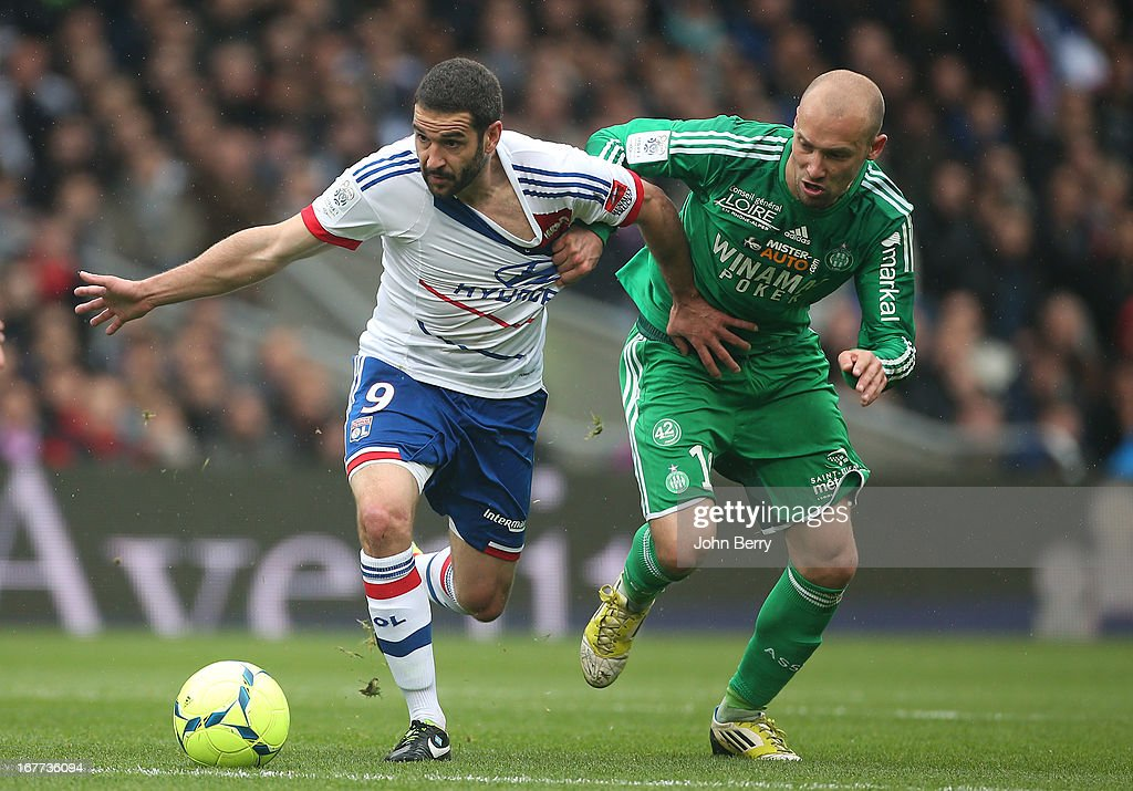 Lisandro Lopez of Lyon and <a gi-track='captionPersonalityLinkClicked' href=/galleries/search?phrase=Renaud+Cohade&family=editorial&specificpeople=2626266 ng-click='$event.stopPropagation()'>Renaud Cohade</a> of Saint-Etienne in action during the Ligue 1 match between Olympique Lyonnais, OL, and AS Saint-Etienne, ASSE, at the Stade Gerland on April 28, 2013 in Lyon, France.