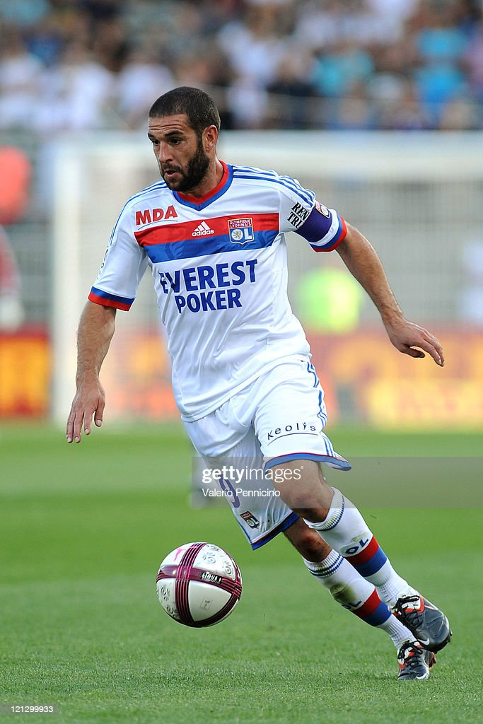 <a gi-track='captionPersonalityLinkClicked' href=/galleries/search?phrase=Lisandro+Lopez&family=editorial&specificpeople=801562 ng-click='$event.stopPropagation()'>Lisandro Lopez</a> of Olympique Lyonnais in action during the Ligue 1 match between Olympique Lyonnais and AC Ajaccio at Gerland Stadium on August 13, 2011 in Lyon, France.