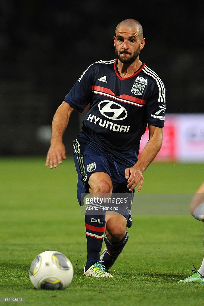 <a gi-track='captionPersonalityLinkClicked' href=/galleries/search?phrase=Lisandro+Lopez&family=editorial&specificpeople=801562 ng-click='$event.stopPropagation()'>Lisandro Lopez</a> of Olympique Lyonnais in action during the Pre Season match between Olympique Lyonnais and Real Madrid at Gerland Stadium on July 24, 2013 in Lyon, France.