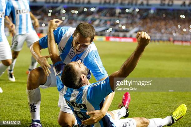 Lisandro Lopez of Racing Club celebrates after scoring the third goal of his team during a match between Racing Club and Independiente as part of...