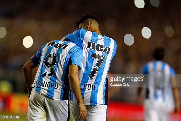 Lisandro Lopez of Racing Club celebrates with teammate Gustavo Bou after scoring the third goal of his team during a match between Racing Club and...