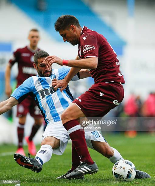 Lisandro Lopez of Racing Club fights for the ball with Diego Braghieri of Lanus during a match between Racing Club and Lanus as part of Copa del...
