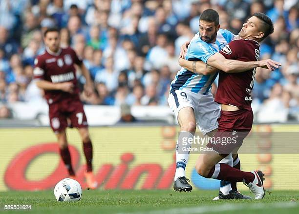 Lisandro Lopez of Racing Club fights for the ball with Marcelo Herrera of Lanus during a match between Racing Club and Lanus as part of Copa del...