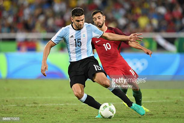 Lisandro Magallan of Argentina and Fernandes Bruno of Portugal compete for the ball during the Men's Group D first round match between Portugal and...