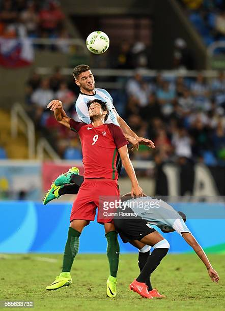Lisandro Magallan of Argentina heads the ball during the Men's Group D first round match between Portugal and Argentina during the Rio 2016 Olympic...