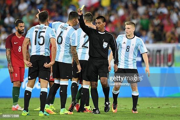Lisandro Magallan of Argentina receives a yellow card during the Men's Group D first round match between Portugal and Argentina during the Rio 2016...