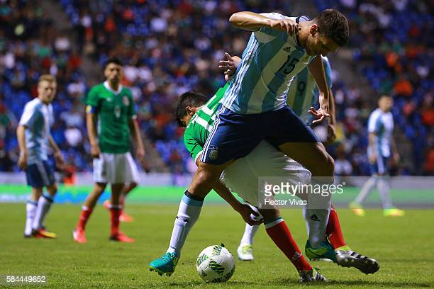 Lisandro Magallan of Argentina struggles for the ball with Erick Gutierrez of Mexico during an U23 International Friendly between Mexico and...