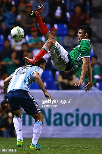 Lisandro Magallan of Argentina struggles for the ball with Hirving Lozano of Mexico during an U23 International Friendly between Mexico and Argentina...