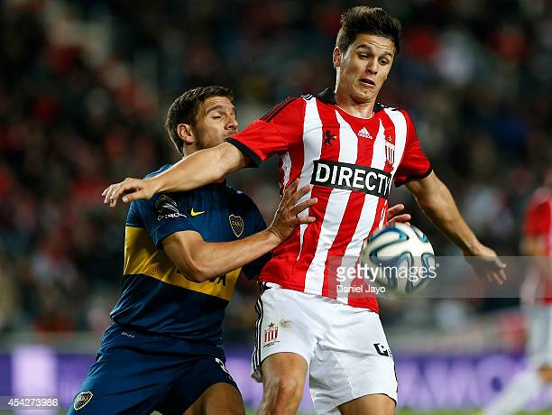 Lisandro Magallan of Boca Juniors and Guido Carrillo of Estudiantes battle for the ball during a match between Estudiantes and Boca Juniors as part...