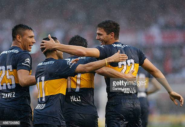 Lisandro Magallan of Boca Juniors celebrates with his teammates after scoring the first goal of his team during a match between River Plate and Boca...