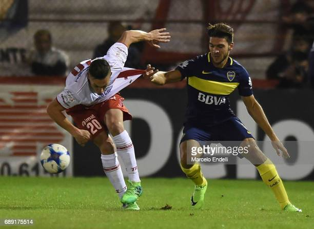 Lisandro Magallan of Boca Juniors fights for ball with Norberto Briasco of Huracan during a match between Huracan and Boca Juniors as part of Torneo...