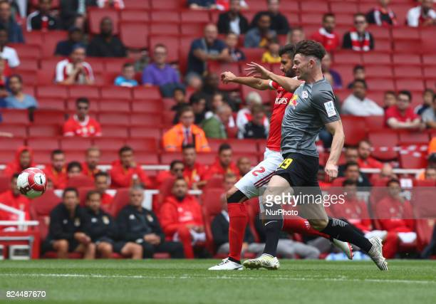 Lisandro of Benfica holds of Oliver Burke of RB Leipzig during Emirates Cup match between RB Leipzig against Benfica at The Emirates Stadium in north...
