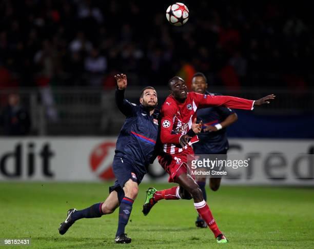Lisandro of Lyon battles with Ludovic Sane of Bordeaux during the Lyon v Bordeaux UEFA Champions League quarterfinal 1st leg match at the Stade de...