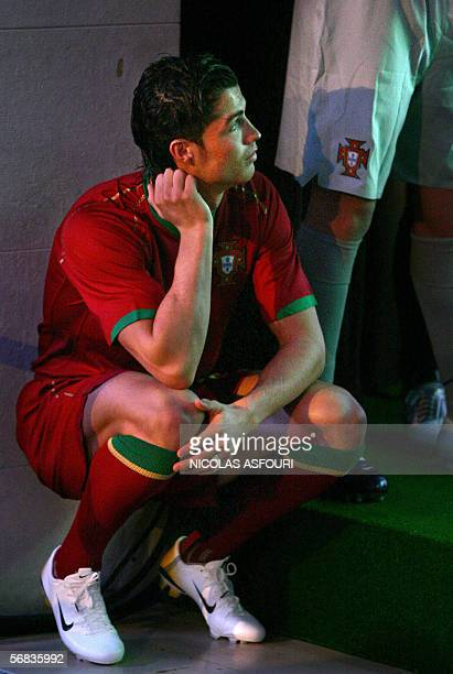 Portugal's Cristiano Ronaldo is watching a commercial movie promoting the Portuguese football team for the World cup 2006 as they present the...