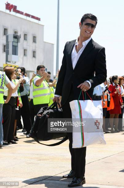 Portuguese national football team player Cristiano Ronaldo poses as he arrives at Portela Airport in Lisbon 09 July 2006 from Germany AFP PHOTO/...