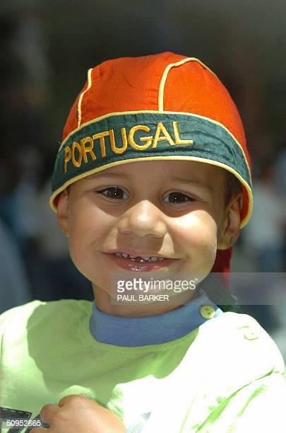 Young Portugal fan Maicelo Rodriguies arrives 12 June 2004 at Lisbon Airport in time for the start of Euro 2004 Football Tournamnent Portugal will...